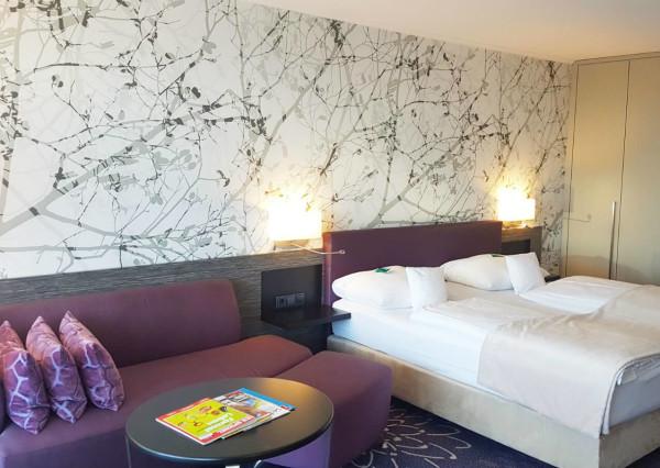 Hotel Si Suites Schlafraum